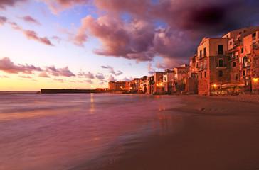 A clam evening sunset on cefalu beach