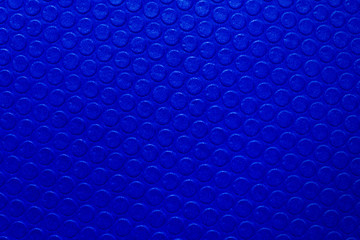 Blue leather surface as background