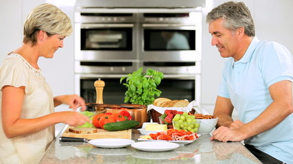 Mature Couple Preparing Healthy Lunch
