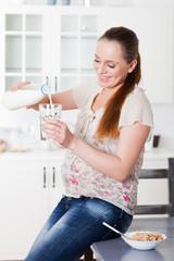 Pregnant woman drinks the milk