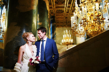 Happy bride and groom in interior of hotel