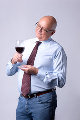 portrait of a successful senior man with glass of wine