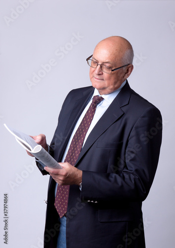 portrait of a successful senior man with book
