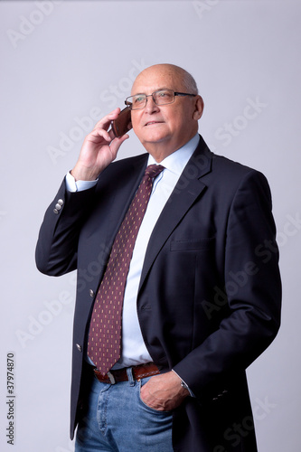 portrait of a successful senior man with phone