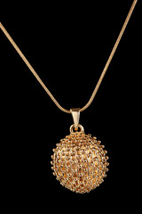 beautiful golden pendant on black background