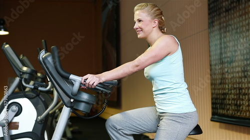 Woman on hometrainer in gym