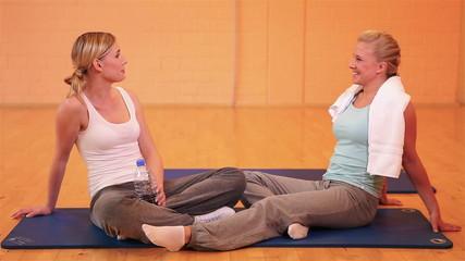 Happy girls talking in gym