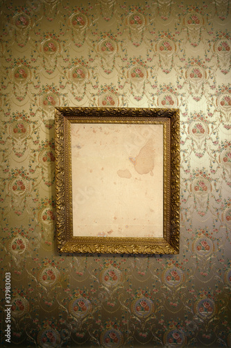 Vintage gold frame and wallpaper
