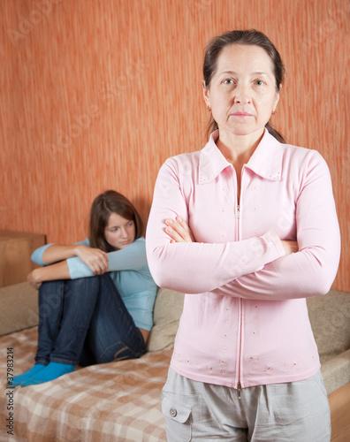 Mature mother and daughter having quarrel