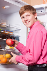 teenager on background refrigerator