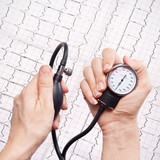 blood pressure gauge in the hands