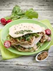 vegetarian sandwich, chapati with tofu arugula and mustard
