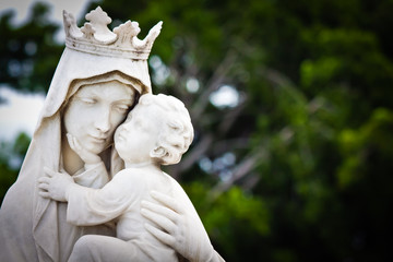 The virgin Mary carrying a baby Jesus statue
