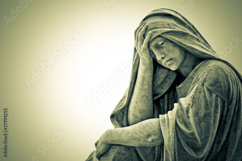 Vintage image of a suffering religious woman statue - 37994253