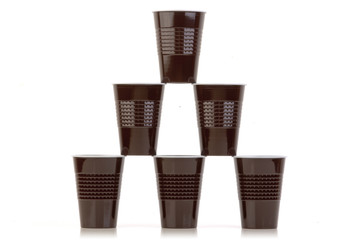 Stack of brown plastic cups arranged on white.