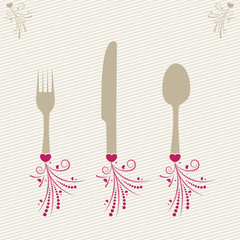 set of forks, spoons and knife with decoratiin
