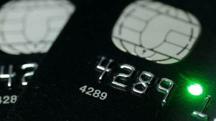 pair of credit card number scanning with green laser