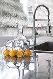 carafes of water and lemons in modern kitchen