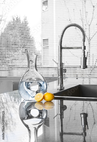 carafe of water and lemons in modern kitchen