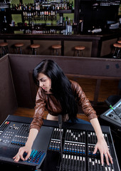 Soundboard technician doing a sound check