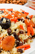 Pilaf made ​​of rice, fresh carrots and dried fruits.