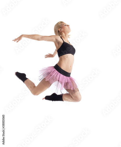 Athletic young woman jump in dance isolated