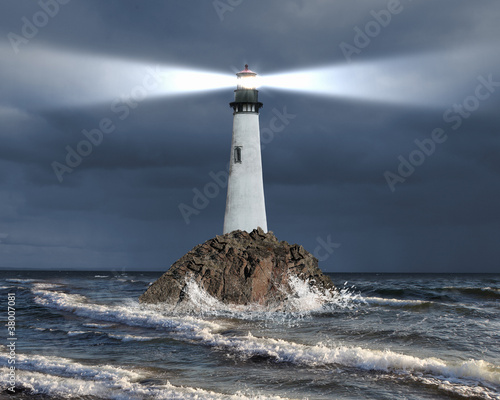 Lighthouse with a beam of light - 38007081