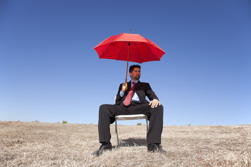 .Businessman with a red umbrella