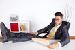 Businessman relaxing at his office