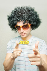 funny guy in afro wig with eyeglasses and ribbon bowtie