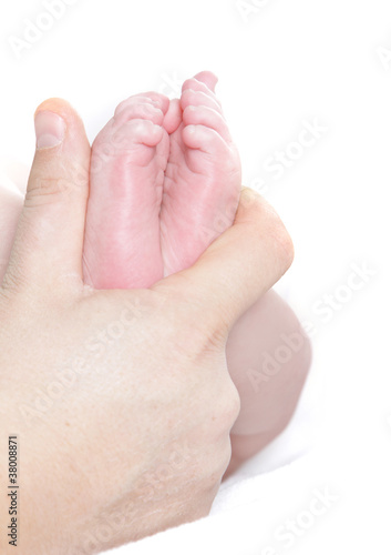 baby's feet in father's hand