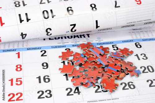 Leinwandbild Motiv Jigsaw Puzzle on Calendar