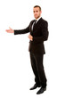 Young business man in welcoming gesture over white background
