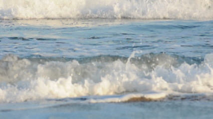 Waves closeup. Sparkling white waves