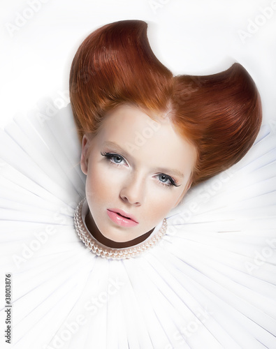 Glamorous young red hair model in white collar and pearls