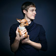 Fashion portrait of beautiful man with small dog
