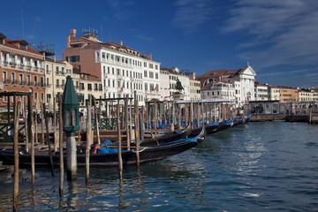 Venice cityscape with gondolas.