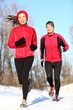 Couple running in winter snow