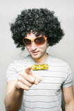 funny guy in afro wig with eyeglasses and ribbon bow