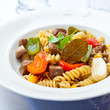 Goulash. Pasta with beef, mushrooms and pepper