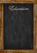education word writing on chalkboard with space