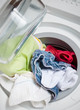 low angle view washing machine full of colorful clothes