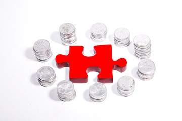 Red puzzle with silver coins