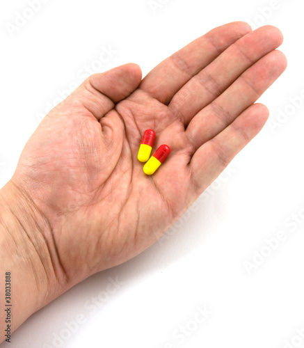 hand holding flu pills