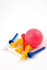 pink golf ball and tees