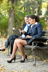businesswomen working in park