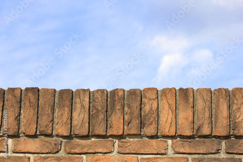 Blue Sky Behind a Brick Wall
