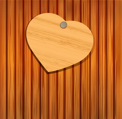 wooden heart on a wooden background for Valentine's Day