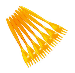 yellow plastic forks isolated on white