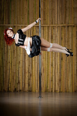 Sexy pole dance woman.